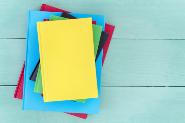 Products and Services - Offset stack of multicolored hardcover books